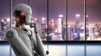 Robot thinking in front of city skyline